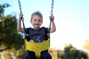 boy on swings at playground