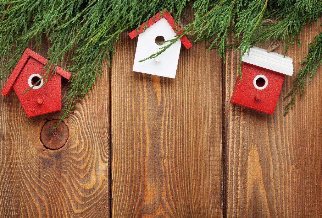 Christmas fir tree and birdhouse decor