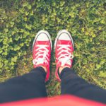 girl-with-red-shoes-in-grass-fpv-picjumbo-com
